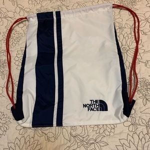 NORTH  FACE drawstring backpack white color